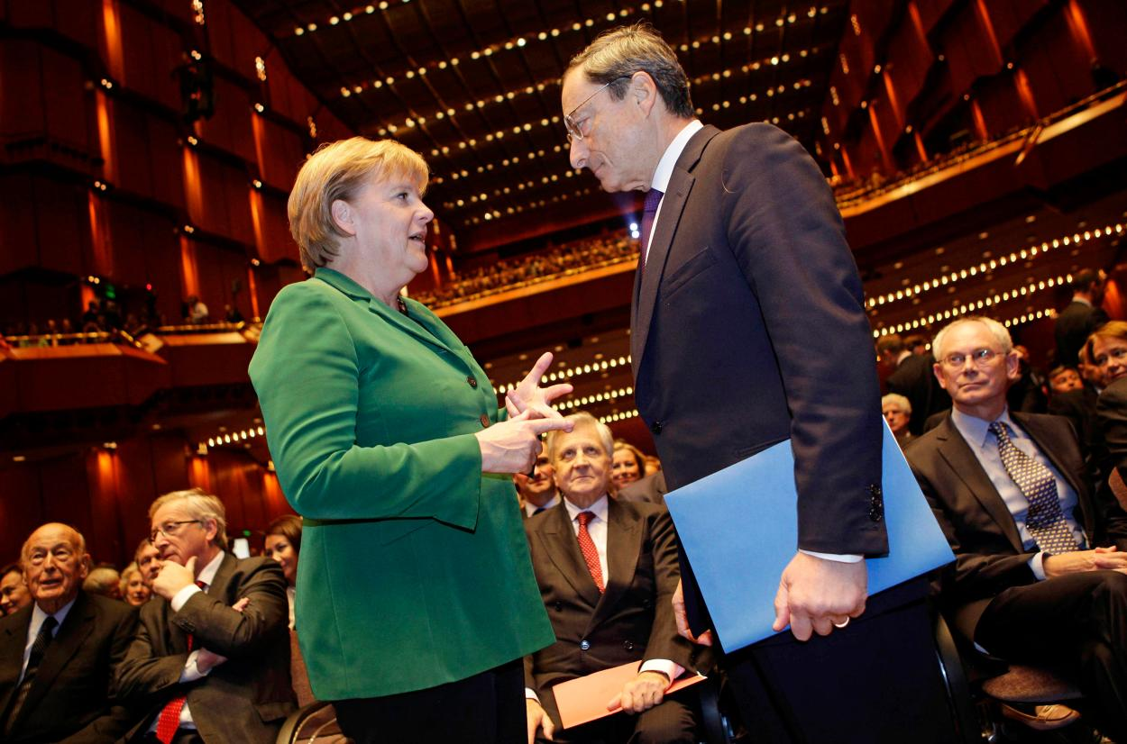 File photo of German Chancellor Merkel talking to new ECB President Draghi prior to a farewell ceremony for outgoing President Trichet in Frankfurt